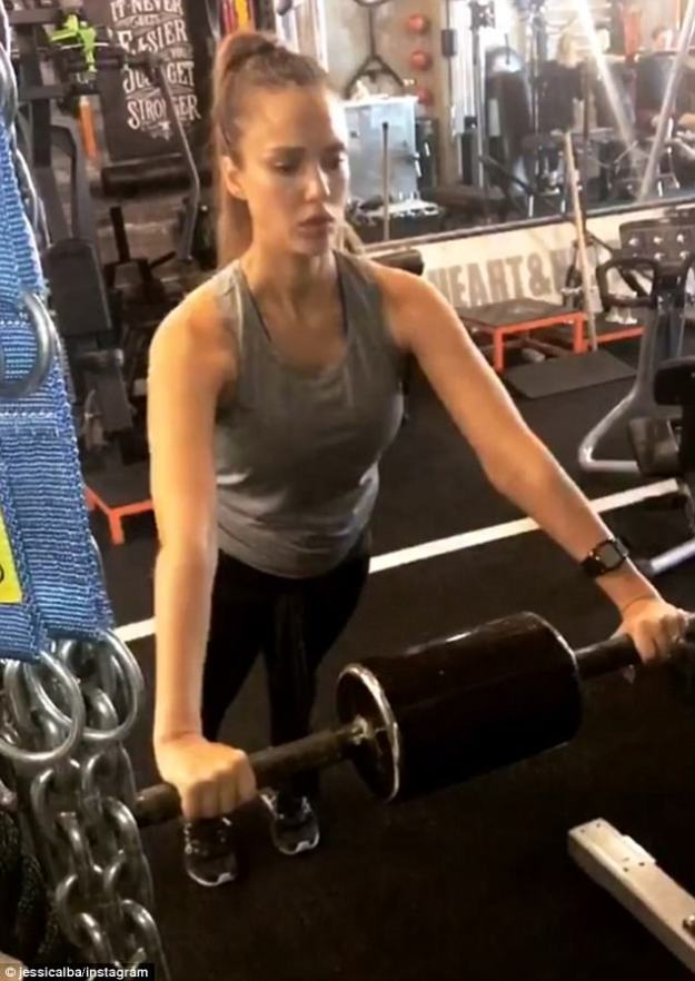 Keeping healthy: The pregnant beauty donned a grey top with her spandex bottoms