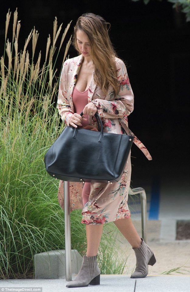 What a beauty:The stunning actress, 36, wowed in a rose colored dress with a floral kimono on Thursday in Los Angeles