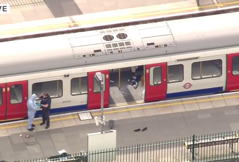 It is believed the bomb was left on the busy district line train from Wimbledon this morning before the bomber escaped. Police are analysing the device to track down the terrorist