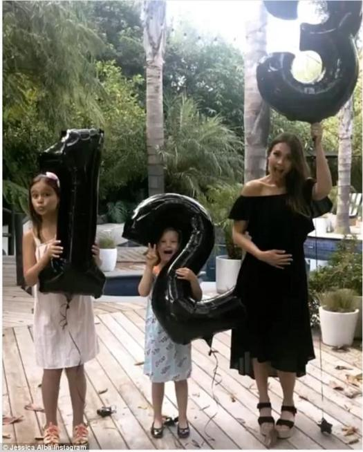 Third on the way: The movie star announced her pregnancy news in an adorable boomerang with her first daughter Honor holding a balloon in the shape of a one and her second daughter Haven holding a two to signify being the second baby