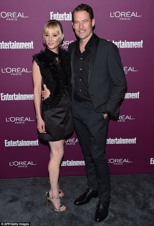 Going strong:Celestial goddess Anne Heche rocked ruffles like no one's business with her partner James Tupper