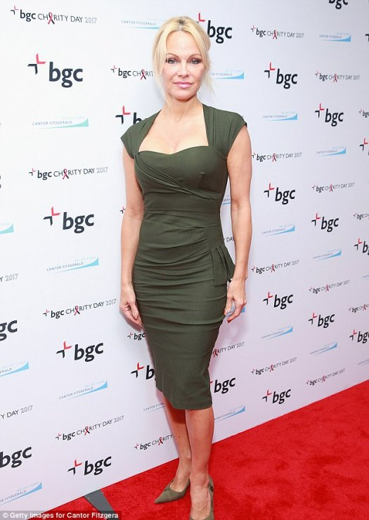Good girl: Pam is seen here at BGC in NYC on Monday raising money