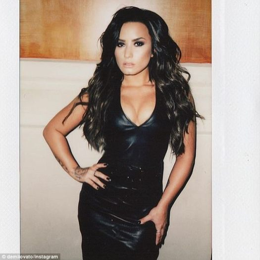 Busty display: Demi - who releases Tell Me You Love Me on September 29 - looks sizzling in a plunging leather dress