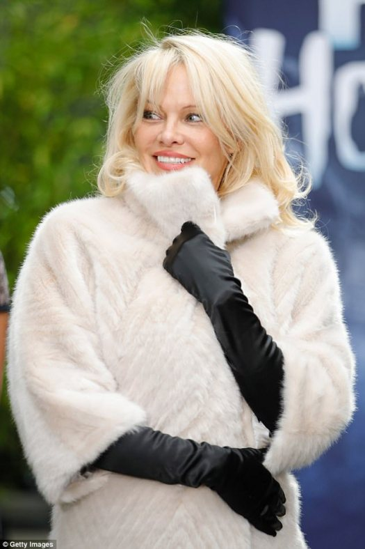 The pinup: Pamela Anderson in a faux fur coat in Germany on Wednesday