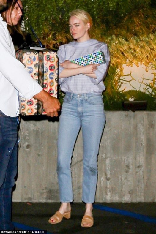 Gifted: Emma Stone carried a present for a friend celebrating their birthday at Fogo de Chao Brazilian Steakhouse in Beverly Hills, California on Friday night