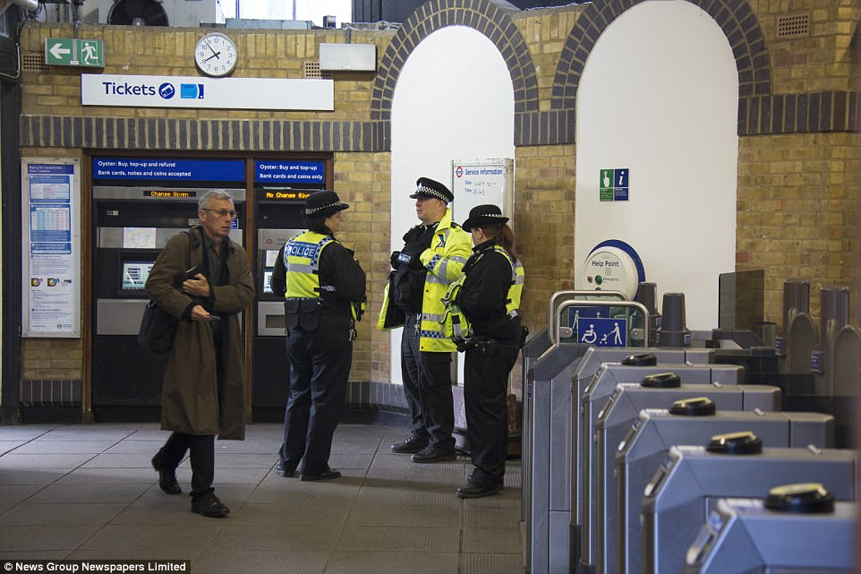 Passengers were pictured going through the turnstiles less than 24 hours after the bomb exploded at the station