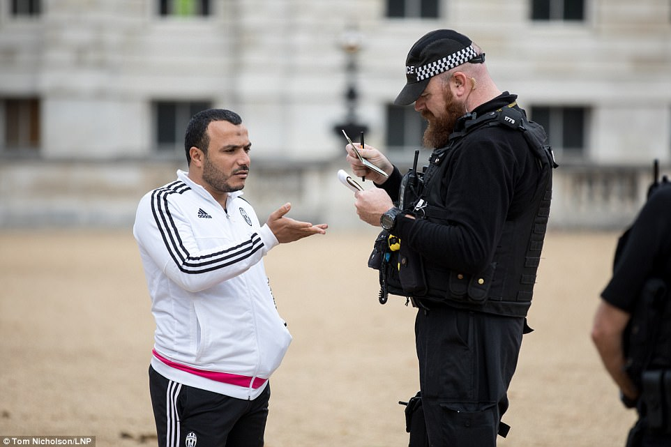 A man has documentation checked as security is increased on Horse Guards Parade