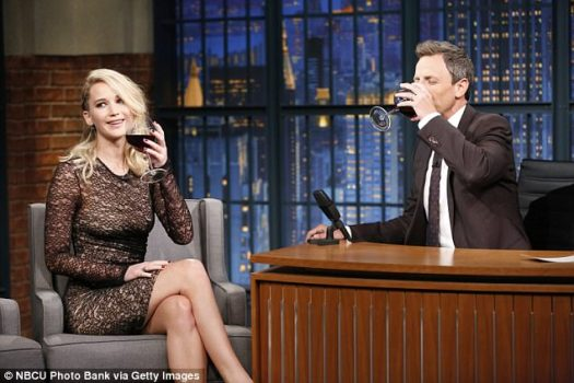 Bottoms up: The star and Late Night host Seth Meyers enjoyed a glass of red wine as she explained that her movie isn¿t exactly a horror even though it¿s billed as one