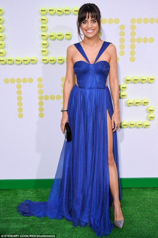 Sapphire stunner: Thigh was the limit for Natalie Morales - who plays Rosie Casals - in a cobalt-blue Maria Lucia Hohan gown featuring a leggy slit selected by stylist Kimmy Erin