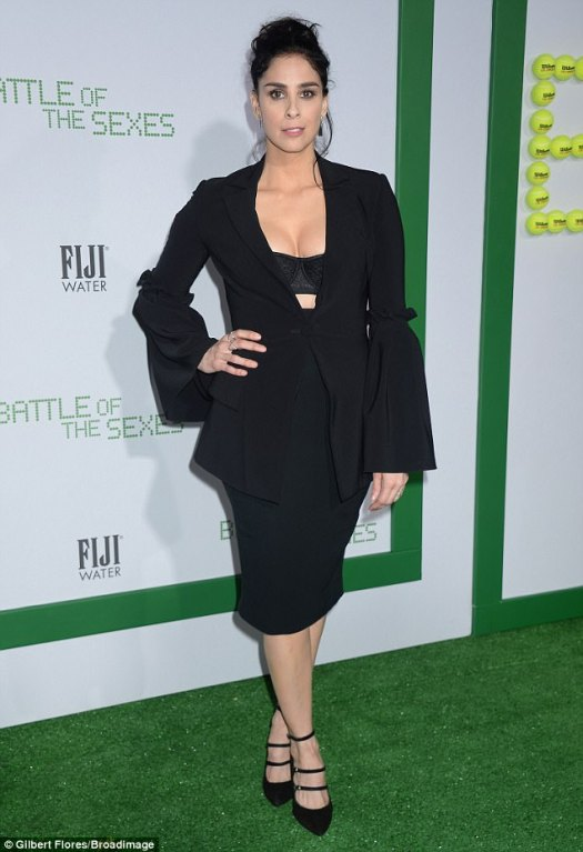 Cleavage alert! Sarah Silverman flashed a hint of black push-up bra beneath her bell-sleeved blazer and pencil skirt to promote her part as World Tennis Magazine founder, Gladys Heldman
