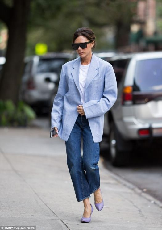 Fashionista:Victoria Beckham, 43, displayed her sartorial prowess as she wore an oversized powder blue blazer and chic wide leg jeans to run errands after her show during LFW on Saturday