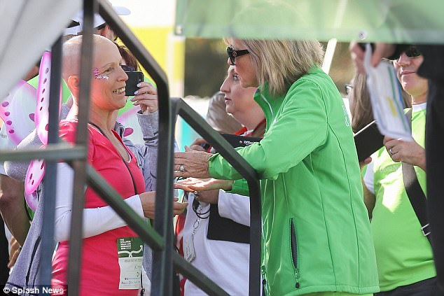 Heart to heart: Olivia was also spotted deep in conversation with a female cancer sufferer