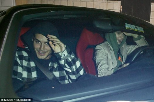 Designated driver: The Keeping up with the Kardashians star first made a dash out of the hotspot's back door with a friend who smiled as she got behind the steering wheel before she was later spotted with Blake