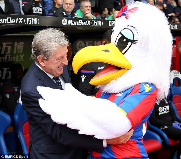 The 70-year-old seemed in a relaxed mood and even had time to hug mascot Alice the Eagle