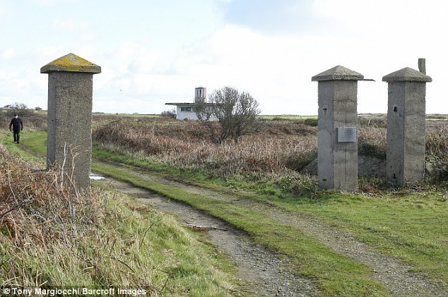The graves of up to 40,000 Jewish, French and Russian prisoners who died in concentration camps in Alderney (pictured) are at risk from a new EU-backed project, archaeologists say