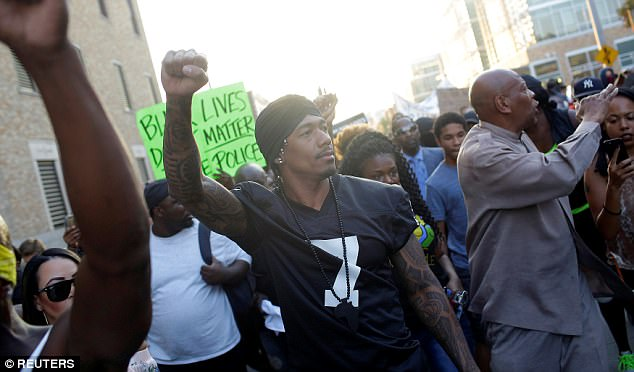Rapper Nick Cannon was among the hundreds of people protesting in St Louis on Saturday night after white police officer Jason Stockley was not guilty of murdering suspected drug dealer Anthony Lamar Smith in 2011
