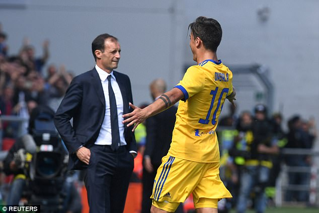 Dybala celebrates with boss Massimiliano Allegri as his team equal Inter Milan at the summit