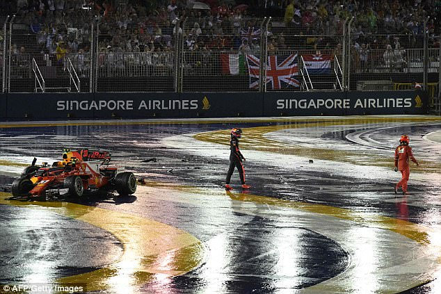 Verstappen looked livid as he left his battered Red Bull car on theMarina Bay Street Circuit
