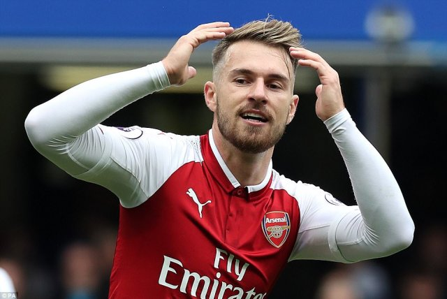 Ramsey holds his head in hands after seeing his effort hit the post and going close to giving his side the lead