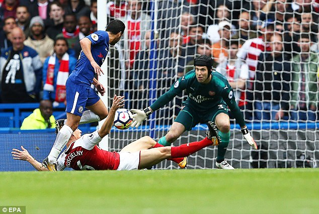 Laurent Koscielny gets across to thwart Pedro with Petr Cech closing down the space