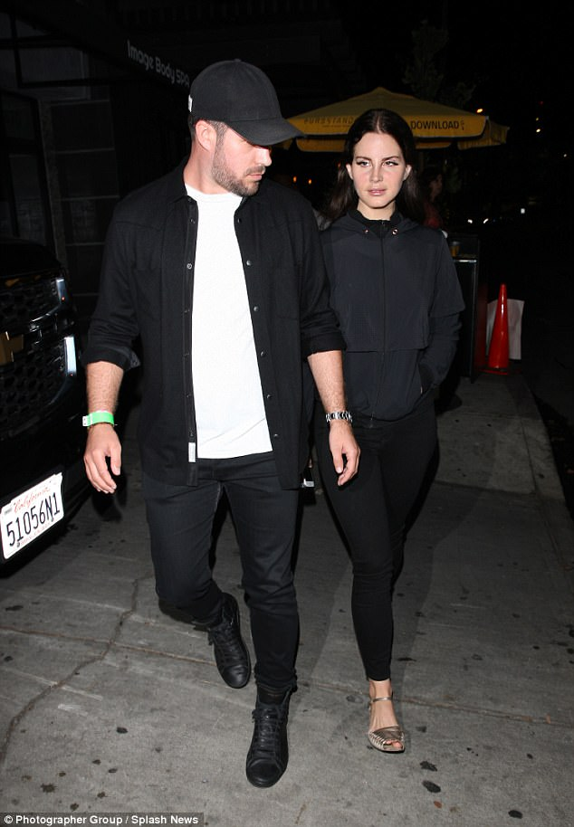 New friend: Here the crooner was seen with a male companion at the Peppermint club to watch comedian Dave Chappelle perform stand up comedy in West Hollywood this week