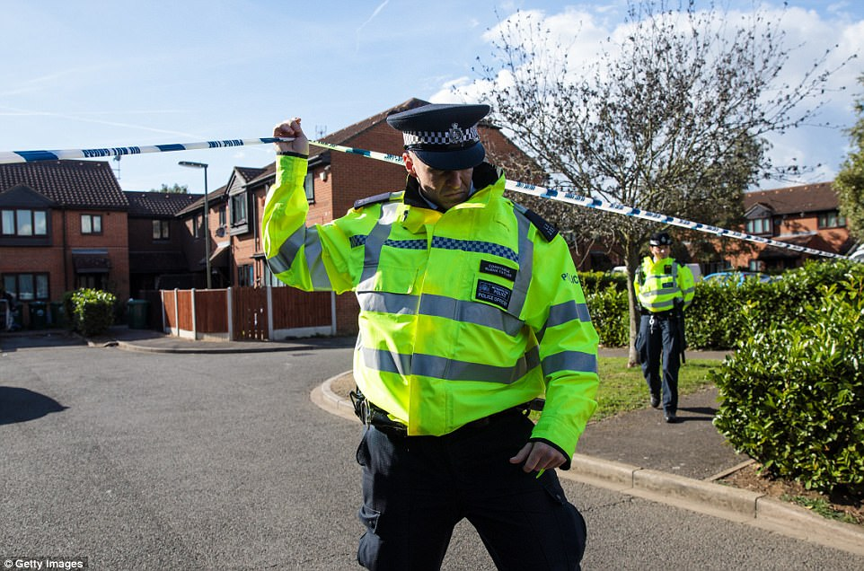 Police officers on the scene during a search on a residential address in Stanwell, Surrey