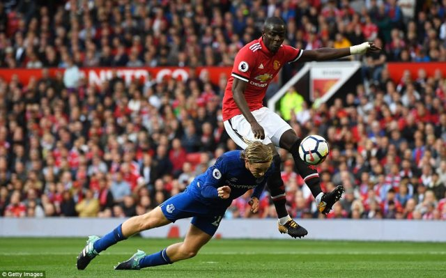 Tom Davies stoops to get his header in at goal but Michael Oliver's assistant ruled the midfielder was marginally offisde