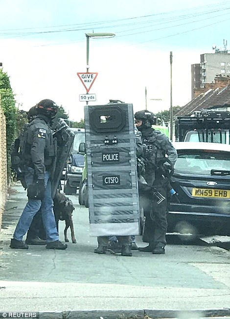 Armed police have raided a residential property in Sunbury-on-Thames in connection to the Parsons Green bombing