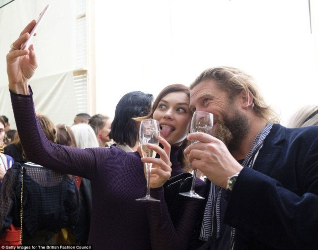 Let me take a selfie: Olga stuck her tongue out as she posed for a selfie with Greg as the pair enjoyed a glass of bubbly