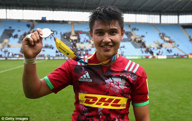 after the matchMarcus Smith of Harlequins celebrates with his man of the match medal
