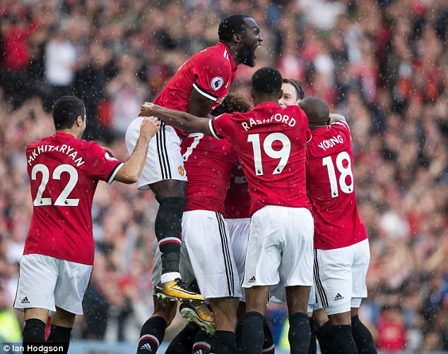 Manchester United players celebrate taking an early lead against Everton at Old Trafford