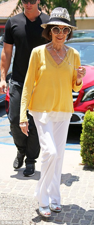 Aging well: MJ, who turned 83 in July looked lovely in yellow and white when she  joined her family at a Color Me Mine craft shop in Los Angeles in June while Kris, 61, showed off her cleavage at an event in New York on September 8