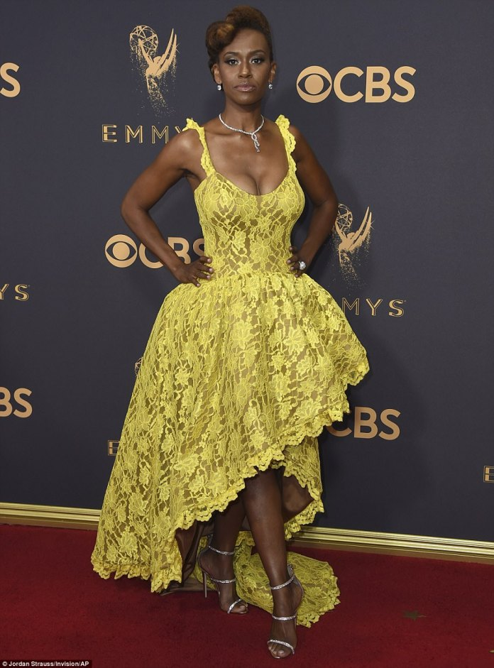 Familiar: MeanwhileRyan Michelle Bathe, the wife of This Is Us star Sterling K. Brown, also plumped for the bold color in this less-than-glamorous lace dress