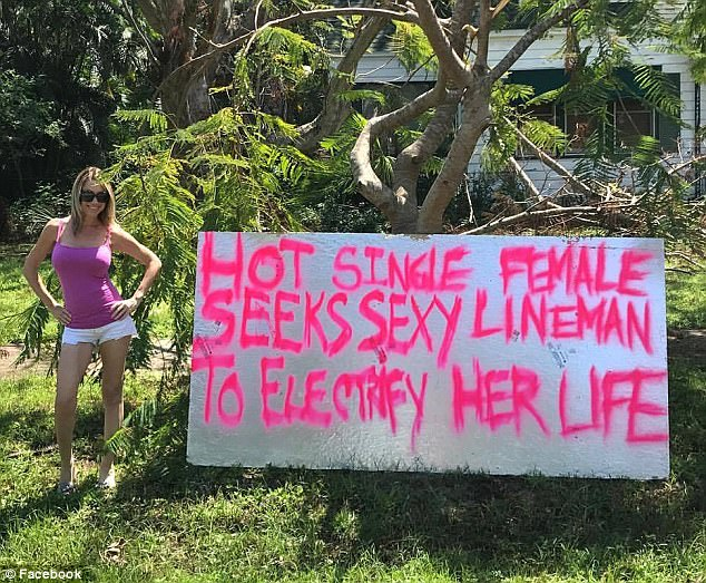 Kynse Leigh, 37, left a large sign in her front yard in Fort Myers, Florida, on Sunday to attract linemen to restore her power which was wiped out by Hurricane Irma