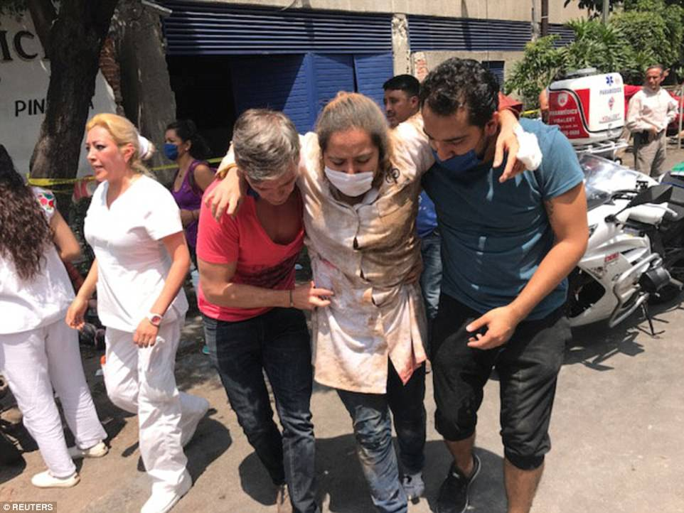 It comes just days after a powerful 8.1 quake hit Mexico killing at least 98 people. Locals are pictured helping a woman during today's incident