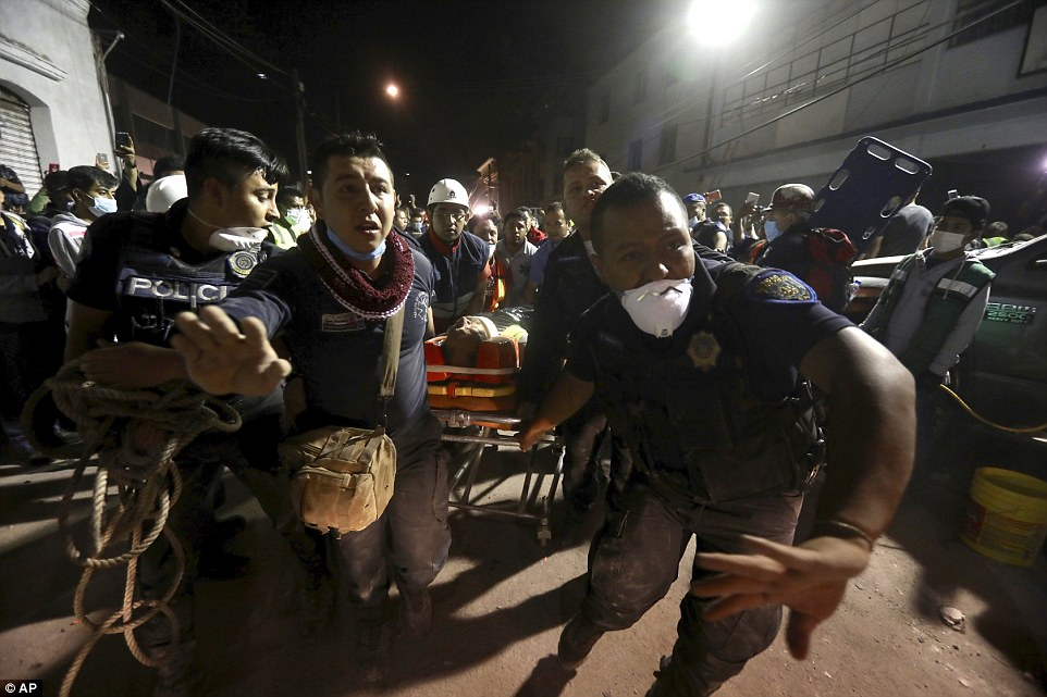 At leas 248 people including 20 children have been killed after a 7.1 magnitude earthquake struck 75 miles southeast of Mexico City, toppling buildings across the city and collapsing a school