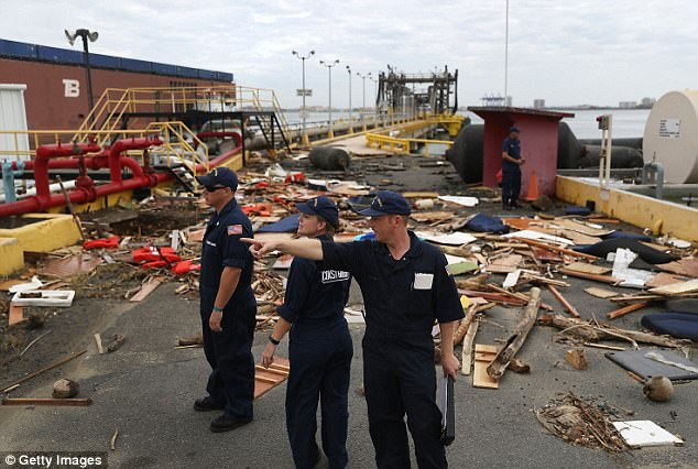 The US Coast Guard personnel surveys the damage to an oil dock after Hurricane Maria passed  through the area in San Juan on Saturday