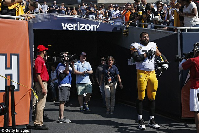 Speaking his truth:Alejandro Villanueva spoke out for the first time since taking the field alone on Sunday for the national anthem (above) while his teammates remained in the tunnel