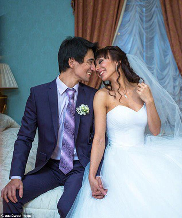 Happier times: Valeev and Ms Pyatyzhkina on their wedding day at an unknown date