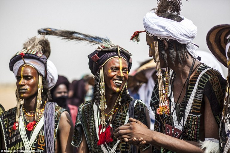 Ritual: Tallness, wide eyes and white teeth are desirable traits of a Wodaabe man, as well as being a good dancer