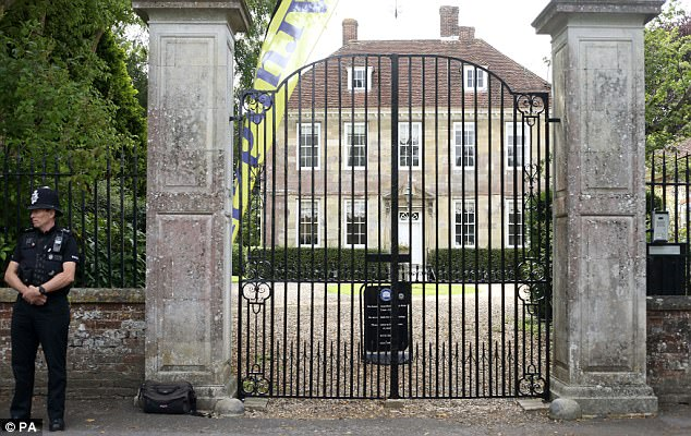 Guard: An officer on duty outside Sir Edward's Salisbury home on the day the abuse inquiry was launched