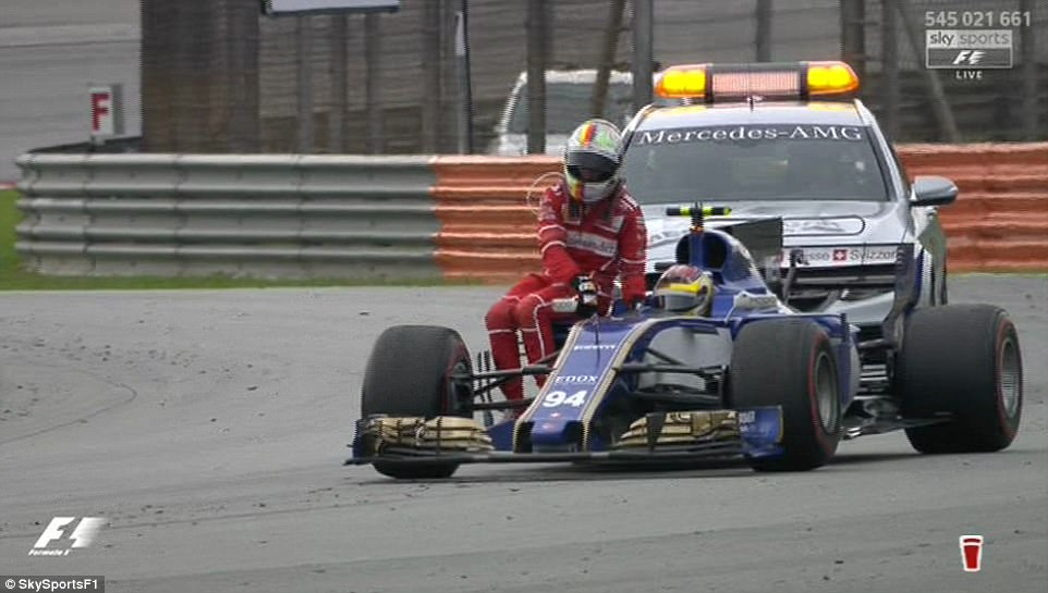 Vettel hopped aboard and the pair took off down the track followed by the safety car