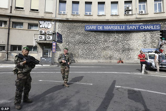 Armed police officers and soldiers swarmed Gare de Marseille Saint Charles (pictured) after the attack early this afternoon