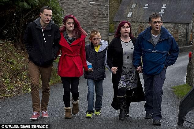 Jazmin (second left) is pictured with her parents, Coral (second right) and Paul (far right), and her brother Harley (centre)
