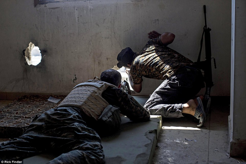 Macer is shown positions of ISIS militants before preparing to shoot targets on the outskirts of Raqqa. He has been fighting with the group for two months. Before that, he fought with the YPG militia