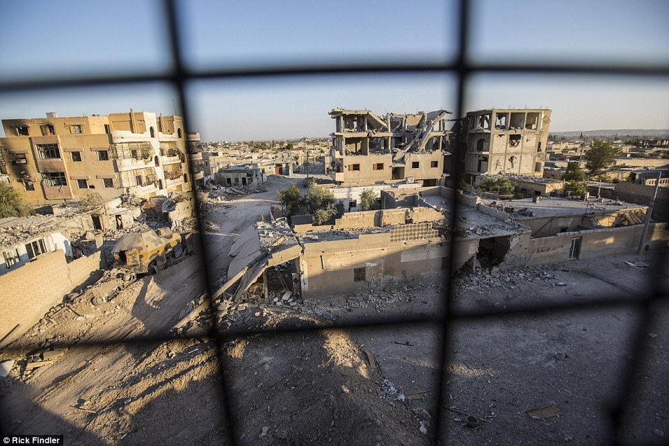 A general view of the Al-Nahda neighbourhood of western Raqqa. While being interviewed for this story, he spoke of a group of MFS fighters he wanted to get moving. He said: 'That's the problem with these guys. They hang around for so long and make so much noise that the ISIS drones just come along and drop a bomb on their heads'