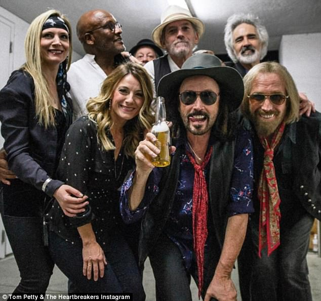 The final picture: Tom Petty, front right, is seen backstage before his final performance at the Hollywood Bowl last week; he has died aged 66 following a devastating cardiac arrest