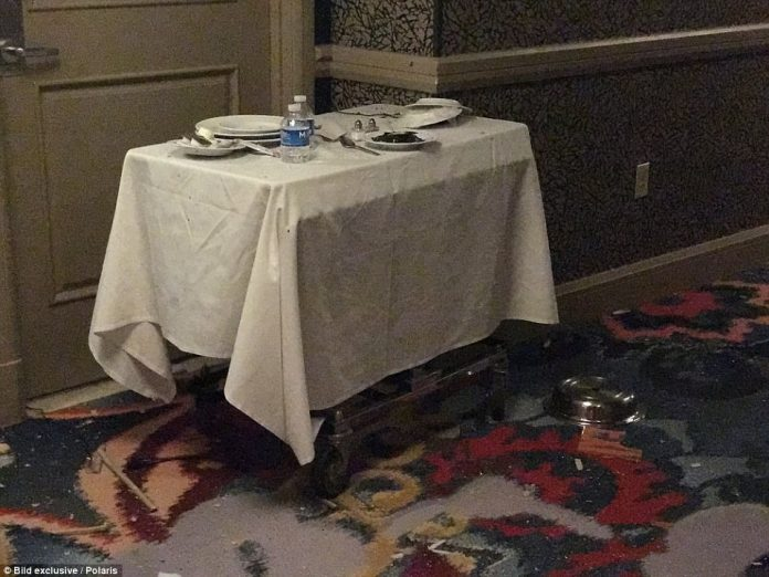 To the right of the doors was a room service cart, covered with empty plates. Paddock set up another camera on the cart to watch the hall. A third camera in the room filmed the shooter. All footage is being examined by the FBI