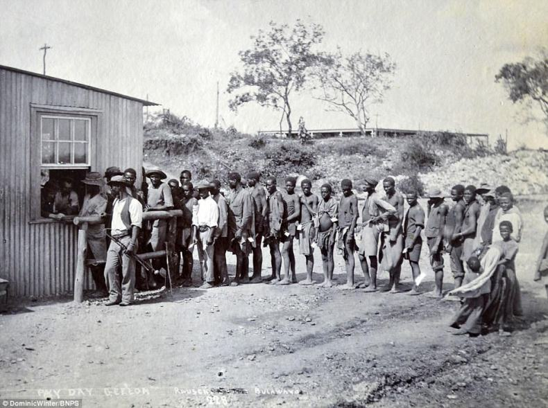 In this photograph native troops can be seen lining up at a hut in the town of Bulawayo