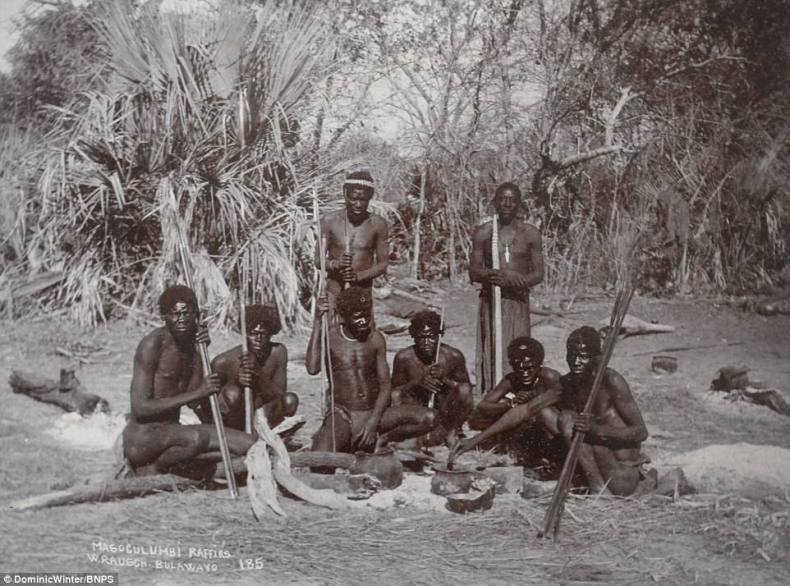 Fascinating photos have been released showing military life in Rhodesia, southern Africa, at the end of the 19th century. Pictured, a native tribe in Rhodesia, now known as Zimbabwe